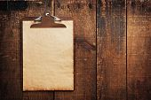 image of clipboard  - Old clipboard on grungy wooden surface - JPG