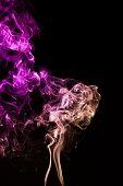 Mistery beautiful smoke on the black background
