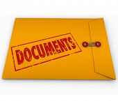 Documents stamped onto a confidential yellow envelope containing important papers, records, historic