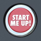 The words Start Me Up on a round car start ignition button to illustrate getting excited, motivated,