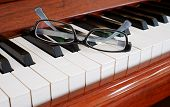 Glasses on a piano
