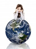 Little girl resting with her arms over a small planet earth, isolated on white background - Image of