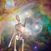 Robot holds galaxy deep space  Elements of this image furnished by NASA