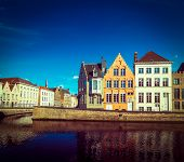 Vintage retro hipster style travel image of Europe town travel background - canal and medieval house