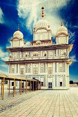 image of sikh  - Vintage retro hipster style travel image of Sikh gurdwara with overlaid grunge texture with overlaid grunge texture - JPG