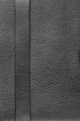 stock photo of black-belt  - Black belt lies on the natural leather can be used as a background texture menu - JPG