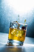 Whisky liqueur glass with ice cubes
