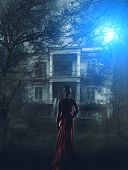 Blonde Woman in red dress at haunted house