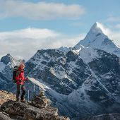 Hiker Walks On Trail In Himalayas