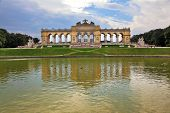 the summer residence of the Austrian Habsburgs. Magnificent colonnade reflected in the smooth water