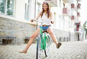 Portrait of happy young woman on bicycle