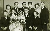 LODZ, POLAND, CIRCA SIXTIES - Vintage photo of newlyweds  with family and friends
