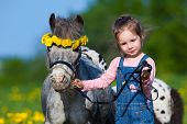 pic of horse-breeding  - Child and small horse in field - JPG