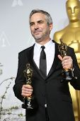 LOS ANGELES - MAR 2:: Alfonso Cuaron  in the press room at the 86th Annual Academy Awards on March 2, 2014 in Los Angeles, California