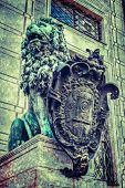 Vintage retro hipster style travel image of Bavarian lion statue at Munich Alte Residenz palace in O