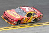 DAYTONA BEACH, FL - FEB 22, 2014:  Regan Smith (7) rest of the field to win the DRIVE4COPD 300 at Da