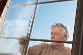 image of window washing  - Man washing windows - JPG