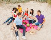 summer, holidays, vacation, music, happy people concept - group of friends celebrating birthday on b