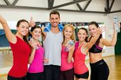 fitness, sport, training, gym and lifestyle concept - group of happy people in the gym with water bo