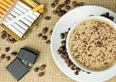 stock photo of cigarette lighter  - Aerial view of cup of coffee lighter and cigarettes - JPG