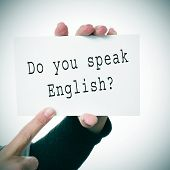 woman hands showing a signboard with the sentence do you speak english? written in it