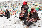MT. KAILASH, TIBET, CHINA �¢�?�? JUNE 3, 2012: Buddhist pilgrims praying at Drolma La pass near holy Mt. Kailash