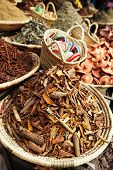 morrocan herbs flowers spices - cassia barks - in the Marrakesh street shop, shallow dof