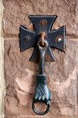 image of entryway  - Interesting old cast iron door knocker in the shape of a man - JPG