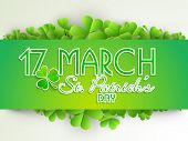 Happy St. Patricks Day celebrations concept with stylish text decorated by Irish lucky four leaf clover on abstract grey background.