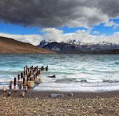 Storm clouds and strong winds in Laguna Azul. Boat dock on the lake. National Park Torres del Paine