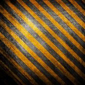 metal background with hazard stripes