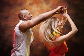 image of samba  - Young couple dances Caribbean Salsa - JPG