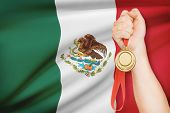 Medal In Hand With Flag On Background - United Mexican States