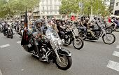 BARCELONA - JULY, 6: Harley-Davidson Motorcycles driving during the Barcelona Harley Days event on the city streets, July 6, 2014 in Barcelona, Spain