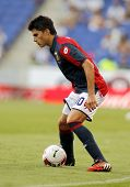 BARCELONA - AUG, 17: Diego Perotti of Genoa CFC in action during a friendly match against RCD Espanyol at the Estadi Cornella on August 17, 2014 in Barcelona, Spain