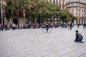 Barcelona, Spain - Feb 9, 2014: Acrobat With Hoop Make Performance At City Square On Feb 9, 2014 In