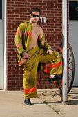 image of firehouse  - Fireman in front of firehouse - JPG