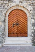 wooden door in stone wall