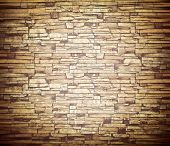 Abstract weathered texture of stained old dark stucco brown and painted red, yellow brick wall backg
