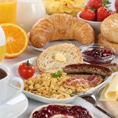 pic of bagel  - Big breakfast with orange juice marmalade sausage cheese bagels fruits and scrambled eggs - JPG
