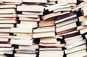 piles of old books in the flea market