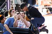 NEW YORK-AUG 19: Singer Jennifer Hudson takes a selfie with fans during a concert at NBC's 'Today Show' at Rockefeller Plaza on August 19, 2014 in New York City.