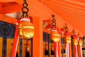 Japanese temple bells in Fushimi Inari Taisha Shrine, Kyoto, Japan.