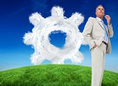 Composite image of thinking businessman against cloud cog