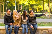 travel, vacation, people, gesture and friendship concept - group of smiling friends waving hands in