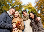 love, relationship, season, friendship and people concept - group of smiling men and women hugging i