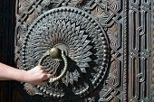 foto of armenia  - The old decorated metal doorknob with a man hand - JPG