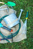 Garden tools on green grass background