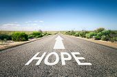 An image of a road to the horizon with text hope