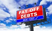 Pay off Debts on Red Billboard.